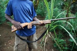 A villager from Kendu, with a self-made gun.