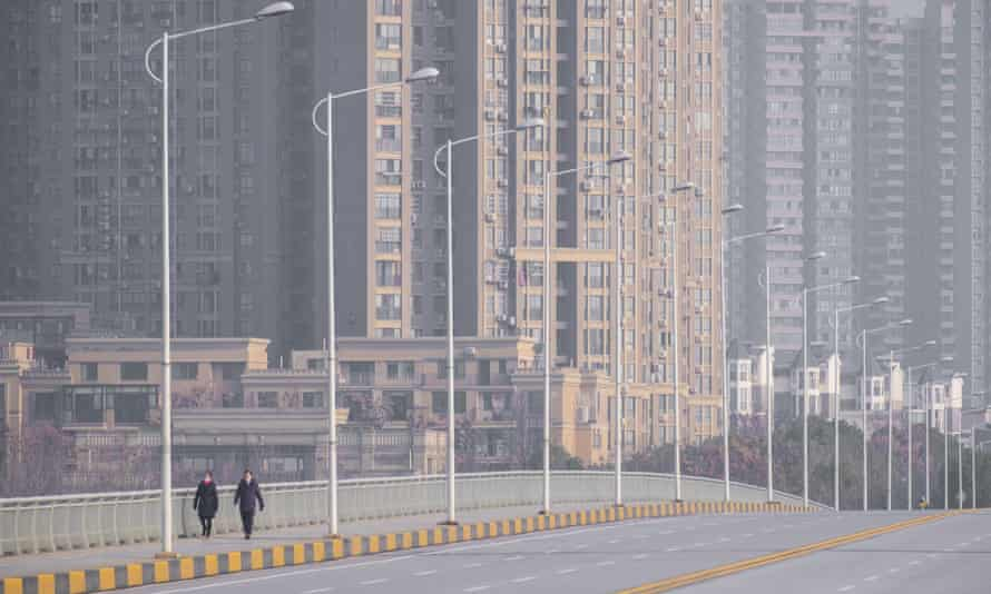 People on a deserted street in Wuhan in late January 2020