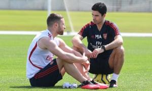 Mikel Arteta talks to Shkodran Mustafi during the warm-weather training camp.