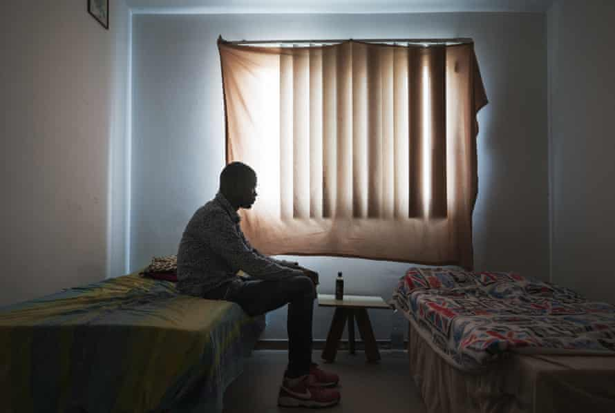 Migrants rescued by Red Cross durring crossing between Libya and Italy. Mineo. Italy Ahmed Beshir 26 years old from Sudan sits on his bed at CARA.