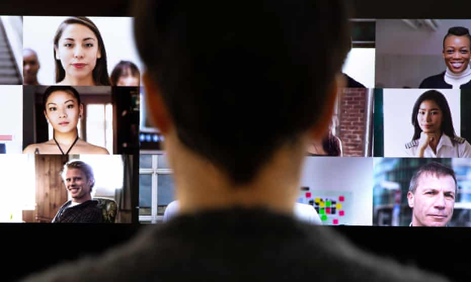 Woman watching video conference with multiple screens