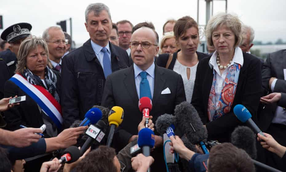 French interior minister Bernard Cazeneuve, British home secretary Theresa May, right, and Natacha Bouchart, mayor of Calais, left, address the media on Thursday.
