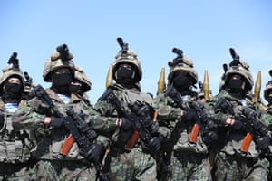 Kazakh soldiers march during Defender of the Fatherland Day