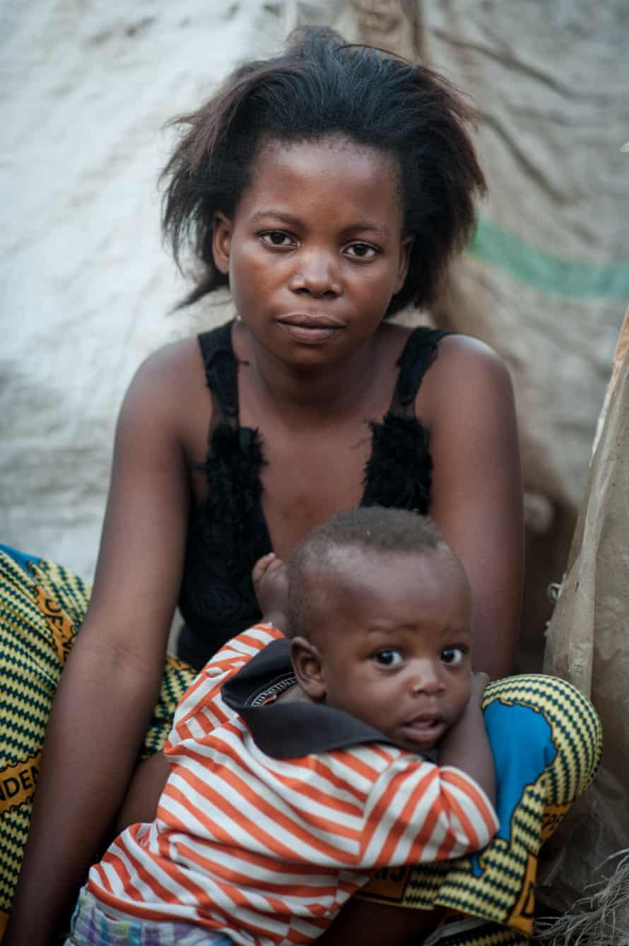 Sango Feaza Sango, 20, with her two-year-old child Kambilo in the grounds of Glory primary school in Kalemie town