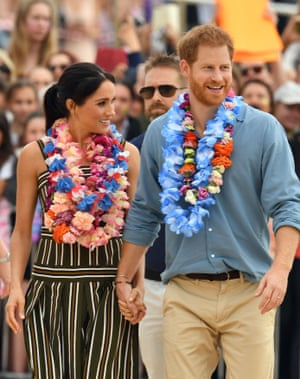 "AUSTRALIA-BRITAIN-ROYALSBritain's Prince Harry and his wife Meghan, Duchess of Sussex leave after a ""Fluro Friday"" session run by OneWave, a local surfing community group who raise awareness for mental health and wellbeing, at Sydney's iconic Bondi Beach on October 19, 2018. - British royals Harry and Meghan kicked off their shoes and donned tropical garlands on October 19, as they hit Sydney's famed Bondi beach for the latest stop on their Australian tour. (Photo by Saeed KHAN / AFP)SAEED KHAN/AFP/Getty Images"