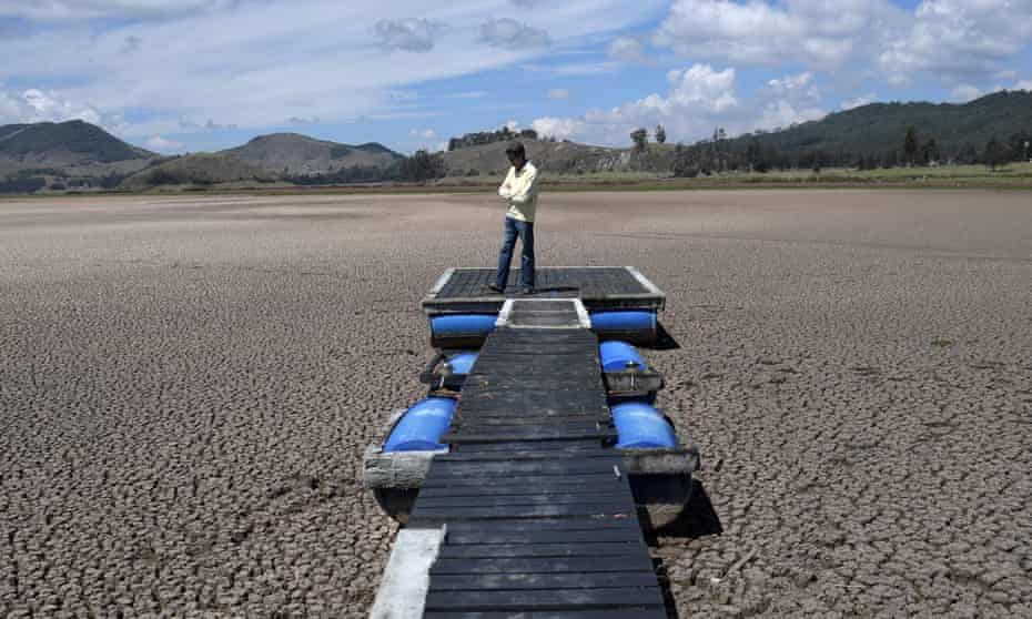 A Colombian engineer, Hernan Sandino, stands on a dock in the Suesca lagoon, which has dried up due to a strong drought exacerbated by climate change. March 2021.