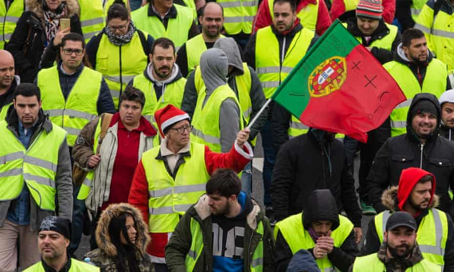 Yellow vests protesters gather in Porto, Portugal, on 21 December to demand an end of the tax on petroleum products and lower VAT on fuels, among other things.