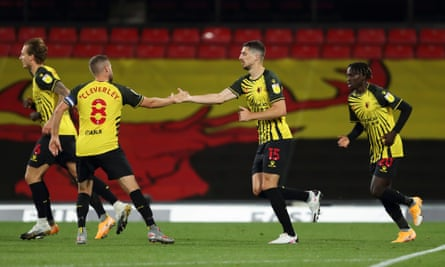 Watford's Tom Cleverley congratulates Craig Cathcart on scoring against Middlesbrough  at Vicarage Road
