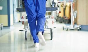 Doctor running in hospital ward