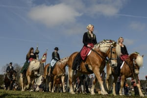 Pilgrims dressed in traditional clothes arrive on horseback