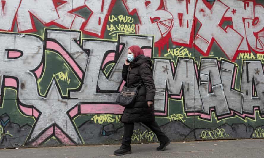 A woman wearing a headscarf in Paris, France