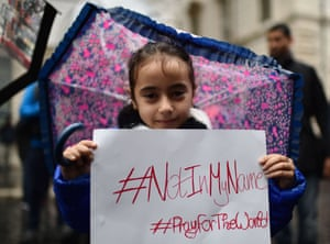 A little girl in Rome holds a placard during a demonstration by Muslims against terrorism a week after Paris attacks.