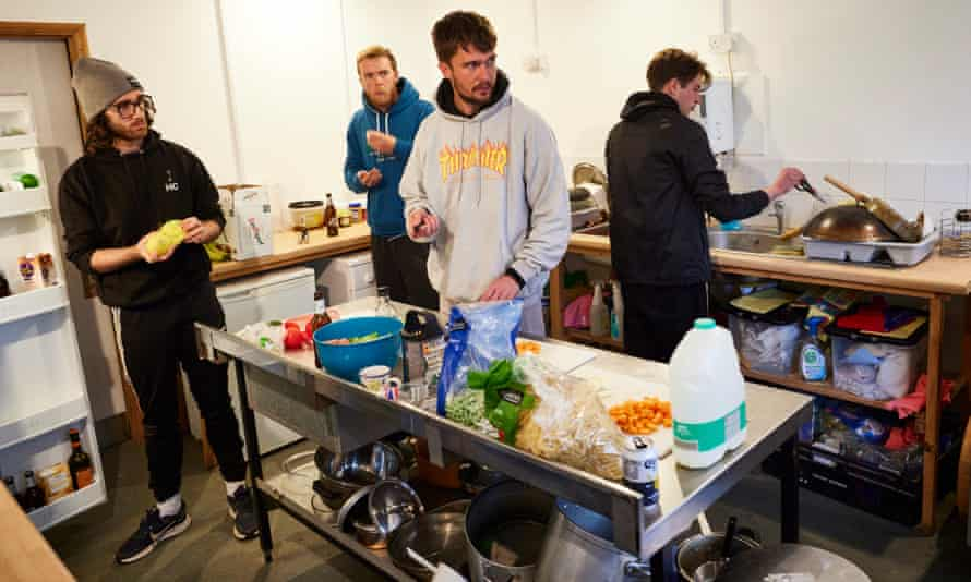 (From left) Harry Clarke (Ross, Seyton), Samuel Lane (Banquo, Mentieth, Gentleman, Siward), Ronnie Yorke (Macbeth, Sergeant) and Rhys Warrington (Lady Macbeth, Third Weird Sister, Young Siward) cook dinner together at their Stanley Hall base camp in Essex.