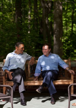 Obama chats with Russian Prime Minister Dmitry Medvedev on the Laurel Cabin patio