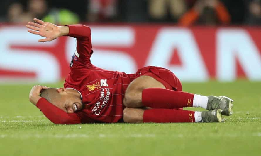 Liverpool's Fabinho reacts after injuring an ankle against Napoli.