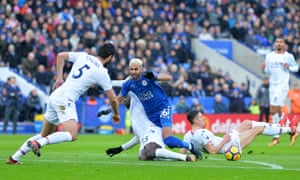 Leicester's Riyad Mahrez is brought down on the edge of the box by Palace's Jeffrey Schlupp.