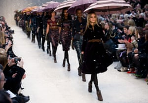 Cara Delevingne leads models carrying umbrellas during the Burberry Prorsum show at London Fashion Week Autumn/Winter 2012 at Kensington Gardens on February 20, 2012 in London, England