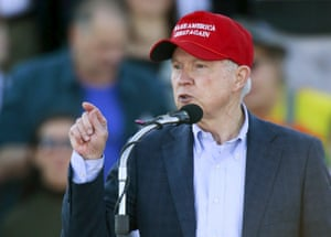 Jeff Sessions speaks in a Trump hat.