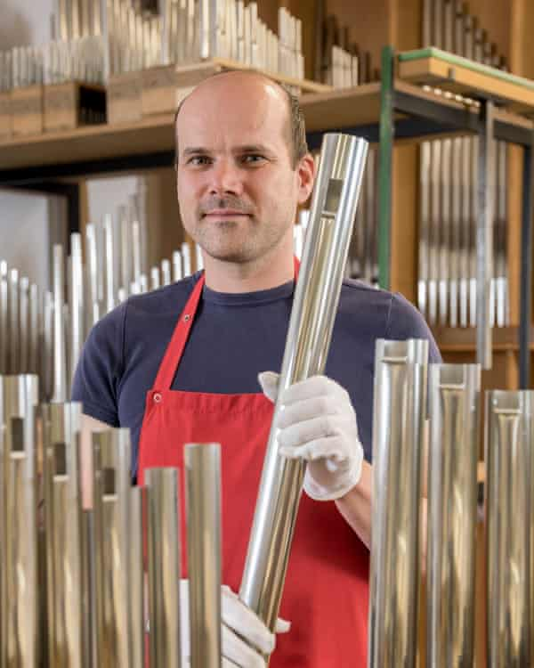 Organ builder, holds an organ pipe of an organ, Laberweinting, Bavaria, GermanyR715BN Organ builder, holds an organ pipe of an organ, Laberweinting, Bavaria, Germany