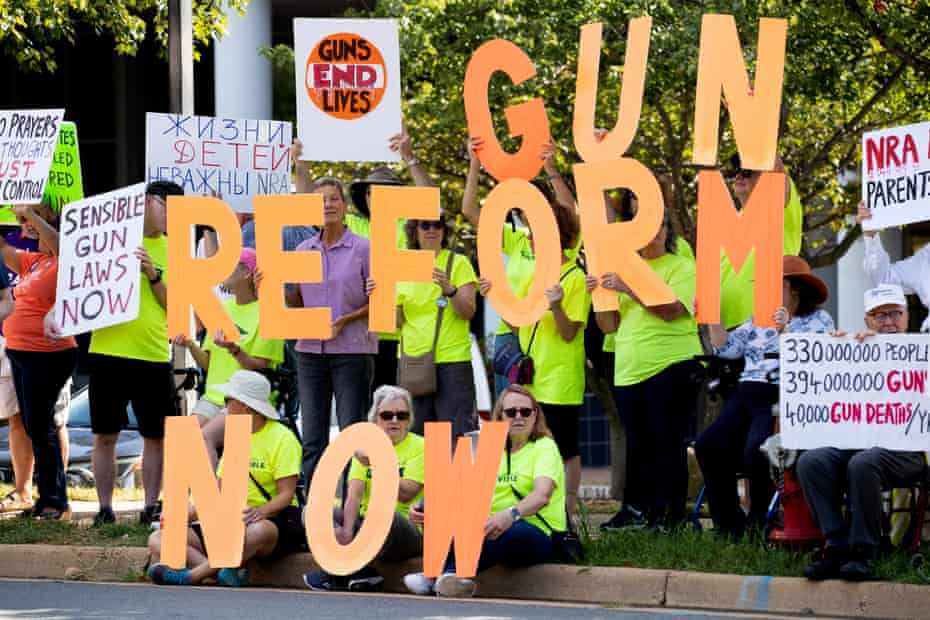 Supporters of gun control reform protest against the NRA at their headquarters in Fairfax, Virginia.
