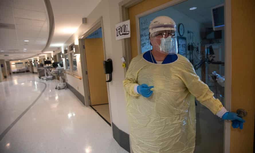 A healthcare worker walks into a Covid patient's room in Torrance, California, on 30 July.