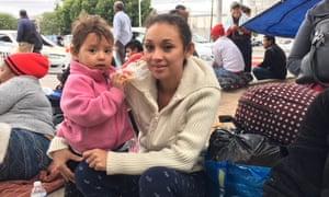 Katarina Francisco, a Salvadorean asylum seeker, with her daughter Allison at Tijuana's US border crossing.
