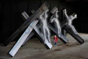 Artist David Mach's most recent piece, Golgotha, which will go on display from 30 July at The City Art Centre, Edinburgh, as part of his exhibition Precious Light. It features figures made from coat hangers and pinned to steel girders.