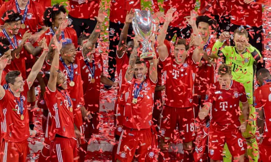Lucas Hernandez holds the Uefa Super Cup after the win over Sevilla last September