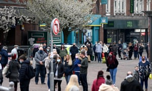 Shoppers queue along the main street to enter the Potteries Shopping Centre in Stoke-on-Trent