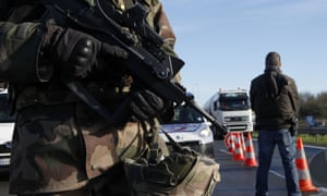 French troops and police monitor the border between France-Belgium border at Neuville-en-Ferrain, northern France.