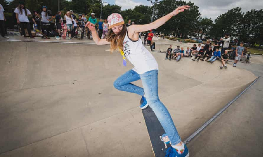 A teenage girl skating at The Level Skatepark in Brighton, East Sussex, England.