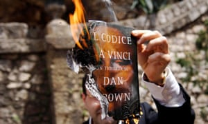 Flaming terrible: Stefano Gizzi, Christian Democrat party's city councillor in Ceccano, sets The Da Vinci Code on fire.
