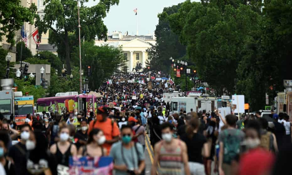 Demonstrators march on 16th Street near the White House on Saturday.