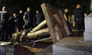 Police stand guard after the Confederate statue known as 'Silent Sam' was toppled by protesters.