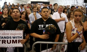People recite the pledge of allegiance before listening to Donald Trump speak at a campaign rally in San Jose, California.