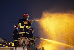 Firefighters in Gauhati spray the streets at night