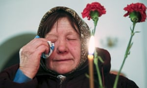 A woman cries during a memorial service for victims of the Chernobyl nuclear disaster in a church in Kiev.