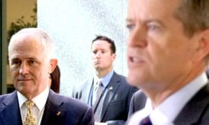 The Prime Minister Malcolm Turnbull watches Opposition leader Bill Shorten speak