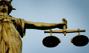 A statue holding the scales of justice is seen on top of the Old Bailey court during the 'Bank of Terror' trial.