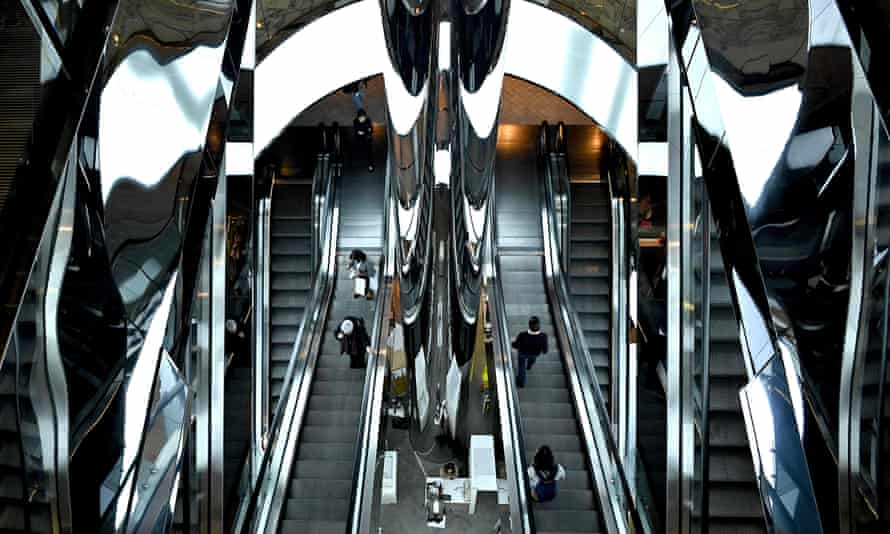 Shoppers on an escalator at a shopping centre in Sydney