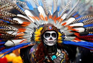 A participant looks on during the annual Day of the Dead parade in Mexico City