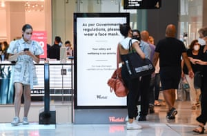 Digital signs encourage customers to wear face masks at Westfield Bondi Junction