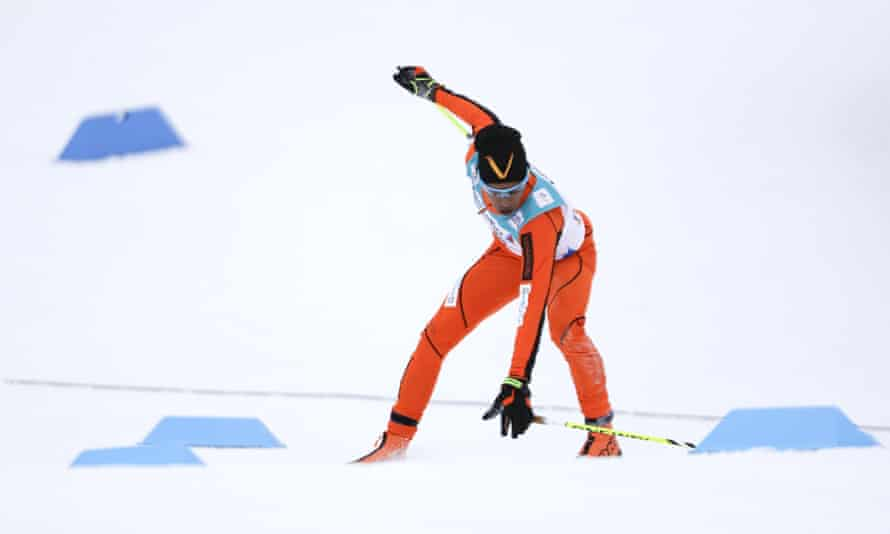 Adrian Solano of Venezuela falls during the men's 10 km cross-country individual classic qualification race.
