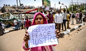 A Sudanese protester holds up a placard during the biggest protest since the former president Omar al-Bashir was ousted.