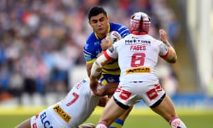 Warrington's Bryson Goodwin is held up by St Helens' Théo Fages and Dominique Peyroux.