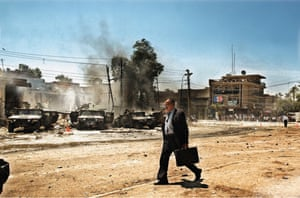 Baghdad, 2004 An Iraqi man walks by the scene of an attack on US Army Humvees that caused several American casualties