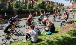 Riders pass through Wimbledon village in London.