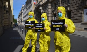 Activists of non-profit organization 'People for the Ethical Treatment of Animals' (PETA) wearing hazmat suits and protective face masks as they rally in front of the Ministry of Agriculture in Paris. They demand the closure of meat slaughterhouses, after cases of coronavirus were detected among abattoir workers at several slaughterhouses in France in recent days.