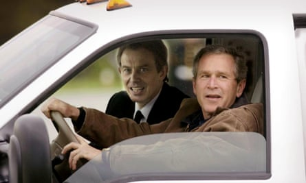 Tony Blair and George Bush arrive at the Bush's Prairie Chapel Ranch in Crawford, Texas on 5 April 2002.