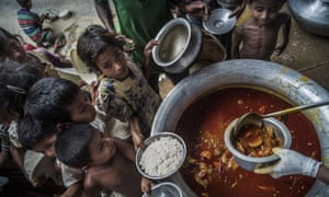 Rohingya children receive food from the Turkish aid agency in Cox's Bazar, Bangladesh.